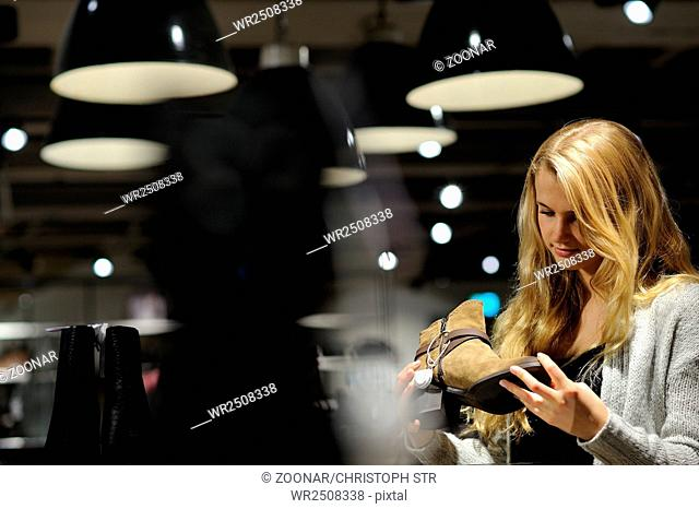 Young fair woman shopping in a department store