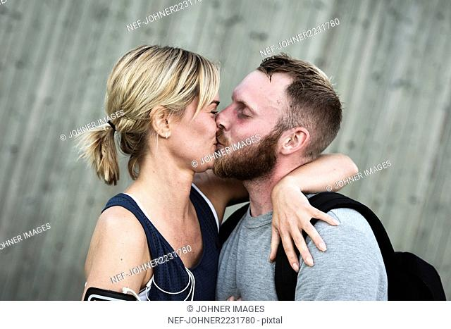 Mid adult couple kissing