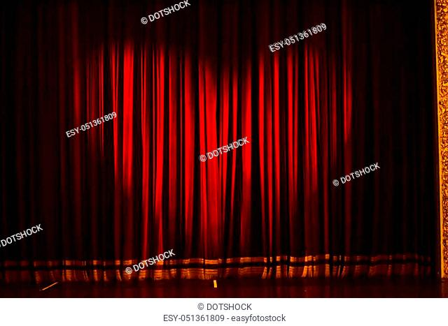 stage curtain or drapes red background with heart symbol ligst shape