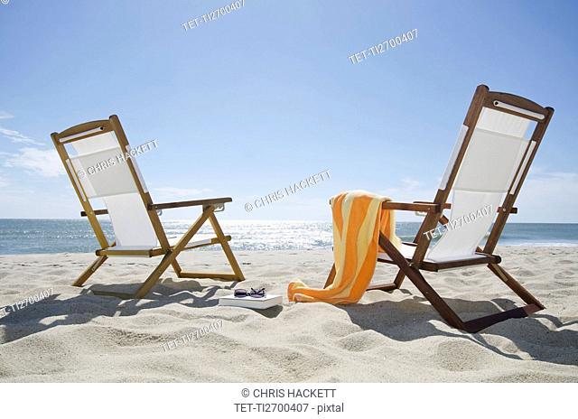 Sun chairs on sandy beach
