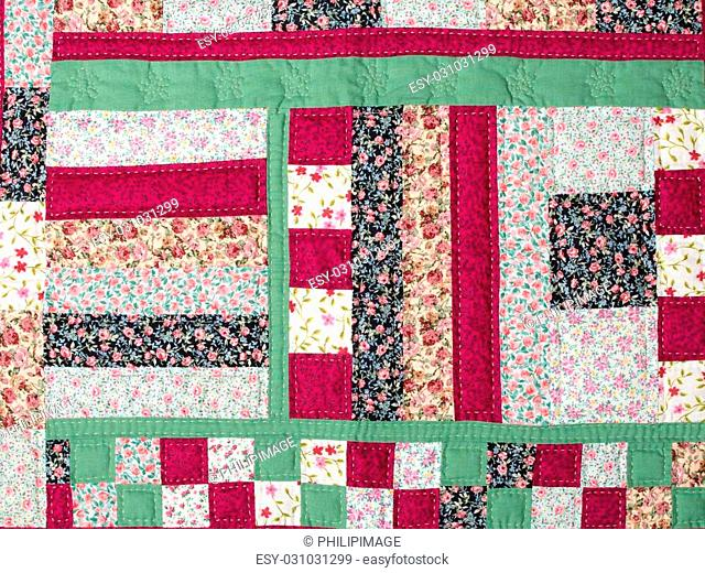a patchwork background with different colored patterns