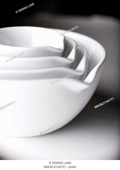 Close up of white nesting bowls with spouts