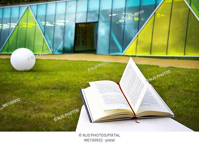 Book opened with the Culture House on the background in Aiete Park, Donostia-San Sebastián, Guipúzcoa, Basque Country, Spain