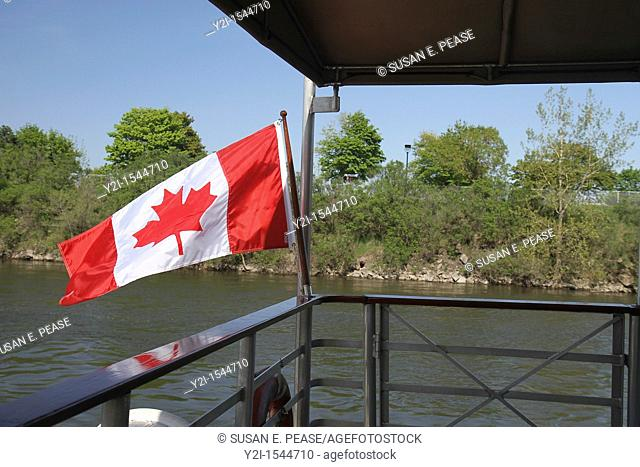 Canadian flag on a sightseeing boat in the Saint Lawrence River, Montreal, Quebec, Canada
