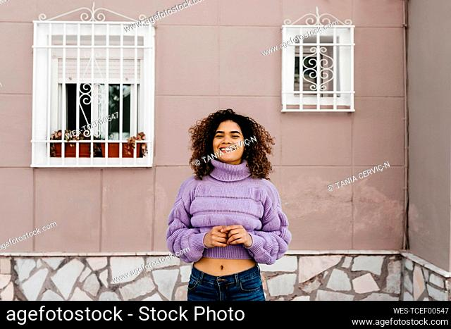 Portrait of smiling woman with windows in the background