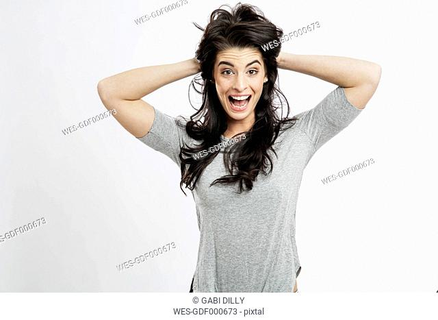 Portrait of excited young woman