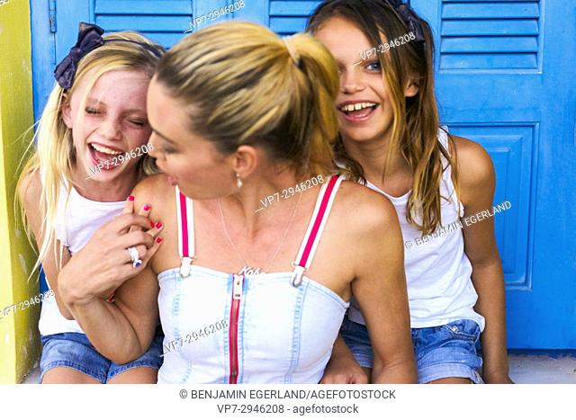 mother teasing with happy daughters. Australian ethnicity. During holiday stay in Hersonissos, Crete, Greece