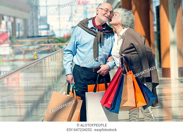 Senior couple with purchases