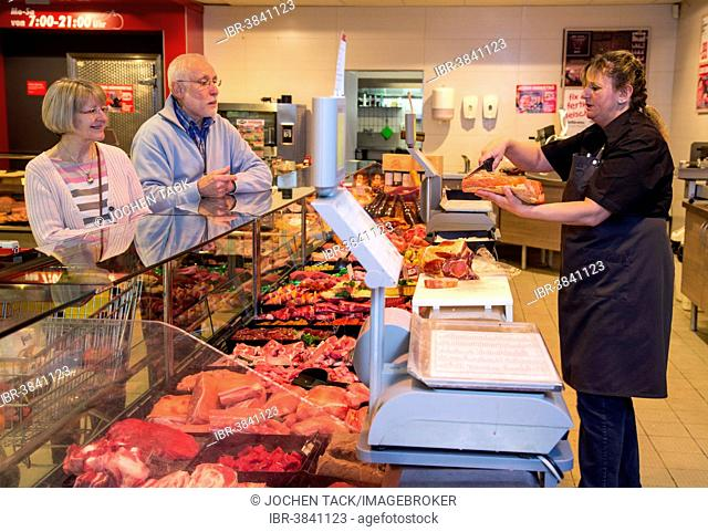 Senior couple shopping at the meat counter in the supermarket, Germany