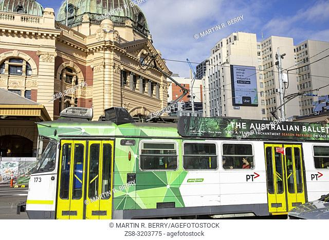 Melbourne tram passes Flinders Street railway station. in Melbourne city centre