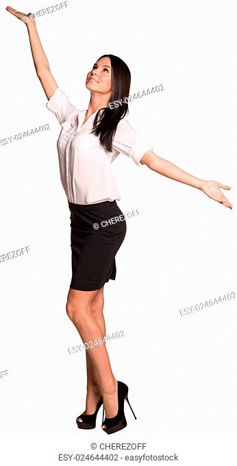 Beautiful businesswomen in blouse and skirt standing and opened her arms to the sides. Isolated on white background