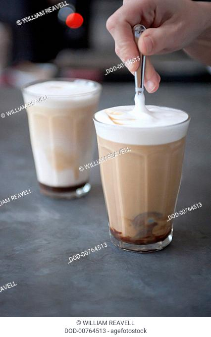Stirring glass of caffe mocha
