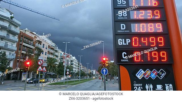 Fuel station signpost. Stormy afternoon at Esplugues de Llobregat city. Barcelona Metropolitan Area, Catalonia, Spain