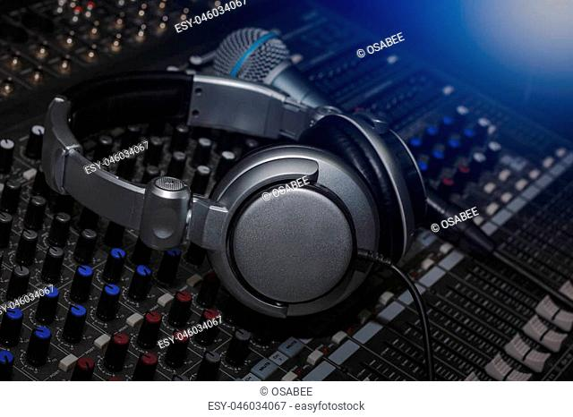 Headphones and Microphone on sound music mixer control panel