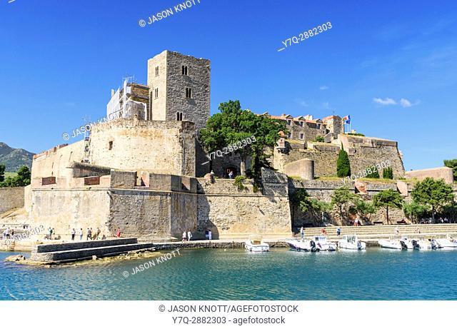 The Château Royal overlooking boats in the small harbour of Collioure, Côte Vermeille, Céret, Pyrénées-Orientales, Occitanie, France
