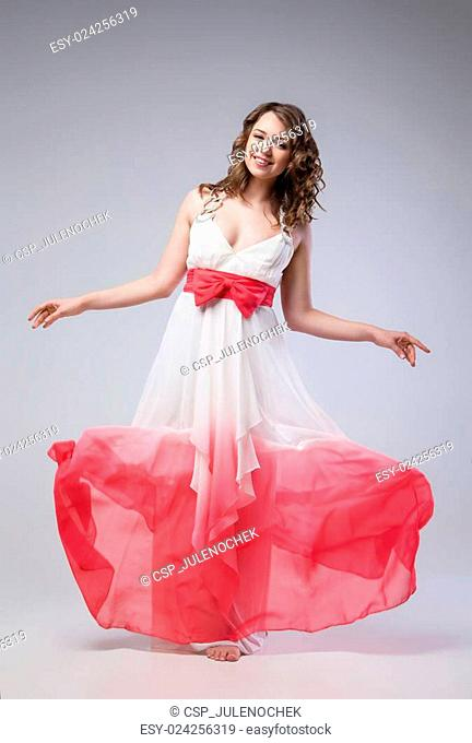 Elegant girl in fluttering dress