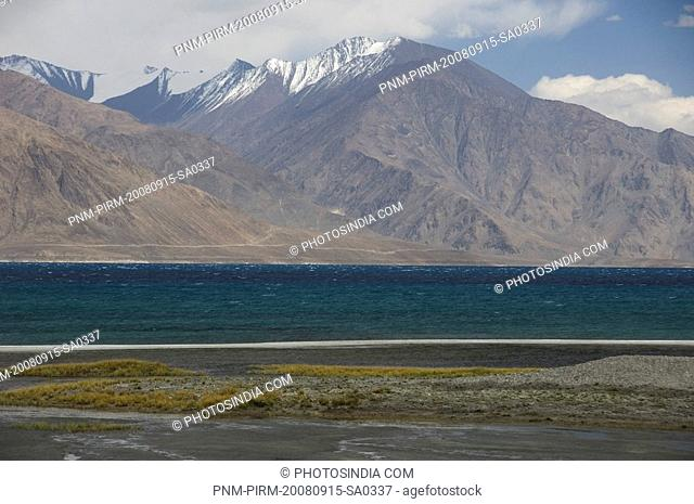 Lake along a mountain range, Pangong Tso Lake, Ladakh, Jammu and Kashmir, India
