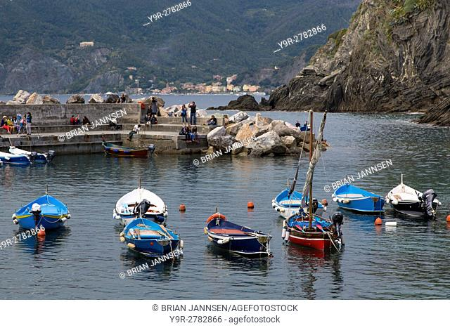Boats in the tiny harbor of Vernazza - one of the Cinque Terre, Liguria, Italy