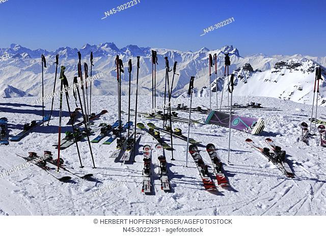 Ski Poles and Helmets, Skis on Snow, Ski Equipment in Snowy Mountain Scene, Haute Savoie, Trois Vallees, Three Valleys, Ski Resort, France, Europe