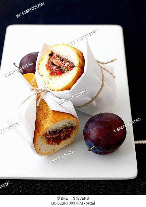 Plate of plums with sandwich