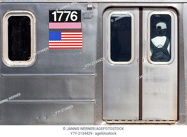 Street photo of detail on an NYC subway car that happens to have a very patriotic registration number: 1776