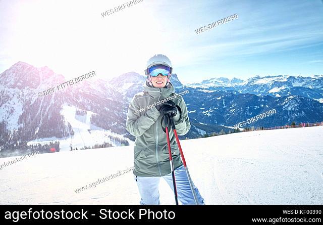Portrait of smiling female skier on ski slope