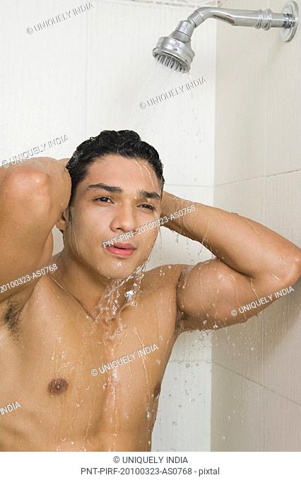 Portrait of a man taking a shower