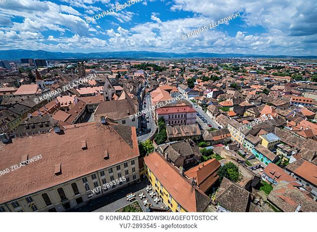 Aerial view on Huat Square from Cathedral of Saint Mary in Historic Center of Sibiu, Romania. Samuel von Brukenthal National College on foreground