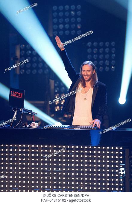 The French House DJ and music producer David Guetta stands on stage during the final of the TV show 'The Voice of Germany' in Berlin, Germany, 12 December 2014