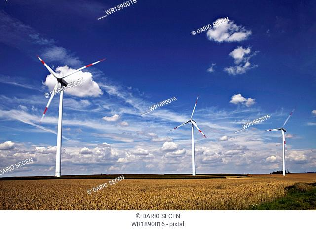 Windfarm On Field, Germany, Europe