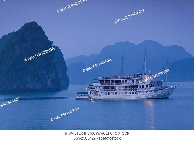 Vietnam, Halong Bay, tourist boats, dusk