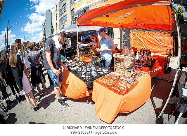 Entrepreneurs sell glass pipes and other marijuana related accessories in Bushwick, Brooklyn in New York at the annual Bushwick Collective Block Party