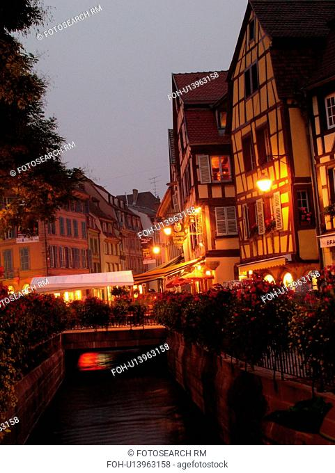 France, Europe, Alsace, Colmar, Haut-Rhin, L'Alsace Wine Region, Route du Vin, downtown, evening, half-timbered buildings, canal