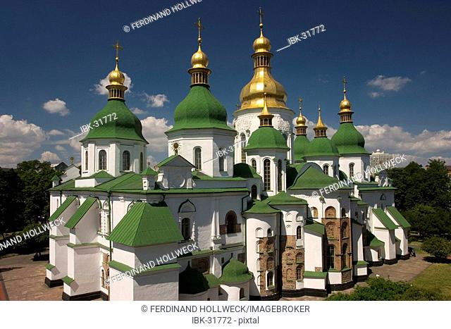 Ukraine Kiev Sophien cathedral 1054 the 13 domes of the cathedral historical building golden domes and crosses shines in the sun blue sky 2004