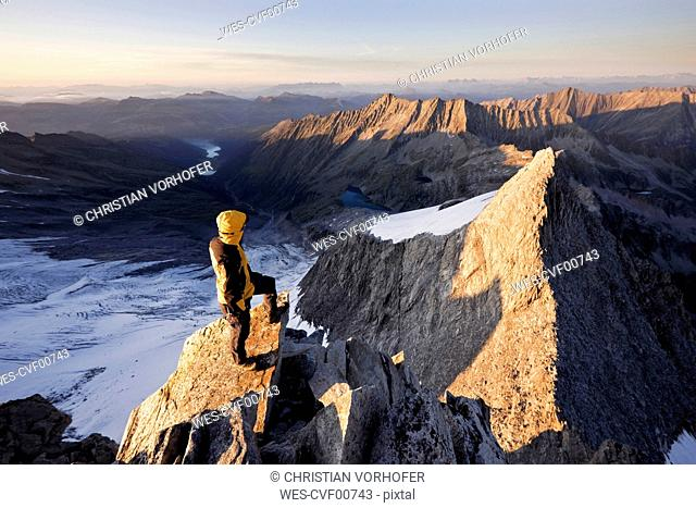 Austria, Tyrol, Zillertal Alps, View from Reichenspitze, climber at glaciated mountains at sunrise, Wildgerlostal, High Tauern National Park