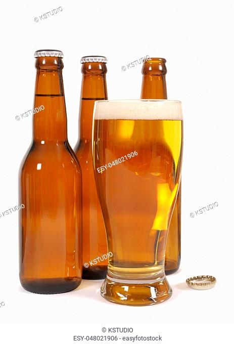Glass of beer with brown bottles and reflections