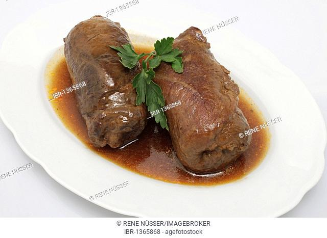 Two stuffed beef rouladen with gravy