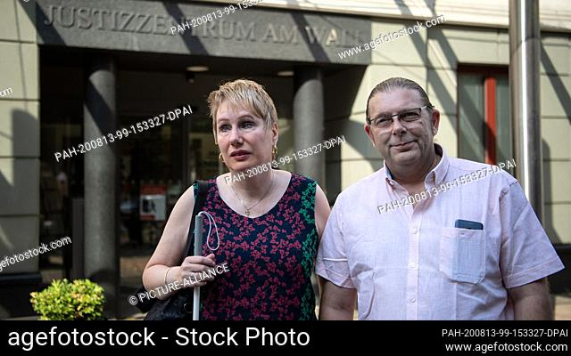 13 August 2020, Bremen: Corinna May (l), singer, stands with her husband Claus Janz before the Bremen State Court. In the proceedings
