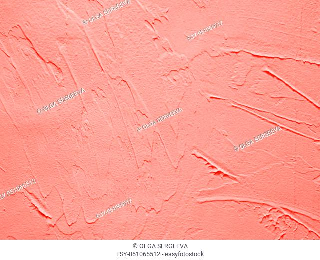 Vintage or grungy background of cement texture in Living Coral color of Year 2019. Decorative plaster effect on wall in Living Coral colour