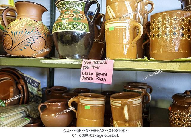 Florida, Immokalee, Mimi's Pinatas, interior, shopping, store, gift shop, display, Mexican clay pottery, sign, bilingual Spanish English, you break you pay
