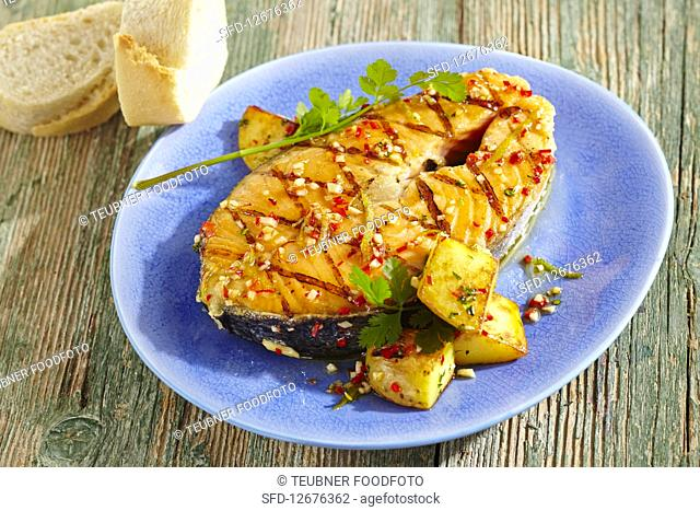 Spicy-marinated, grilled salmon steak with a papaya salad