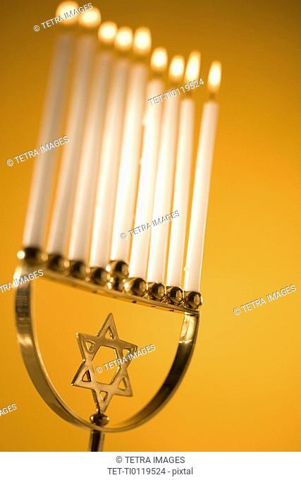 A fully lit menorah