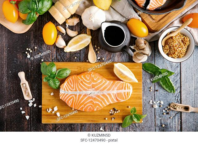 Ingredients for cooking salmon with tomatoes and mustard