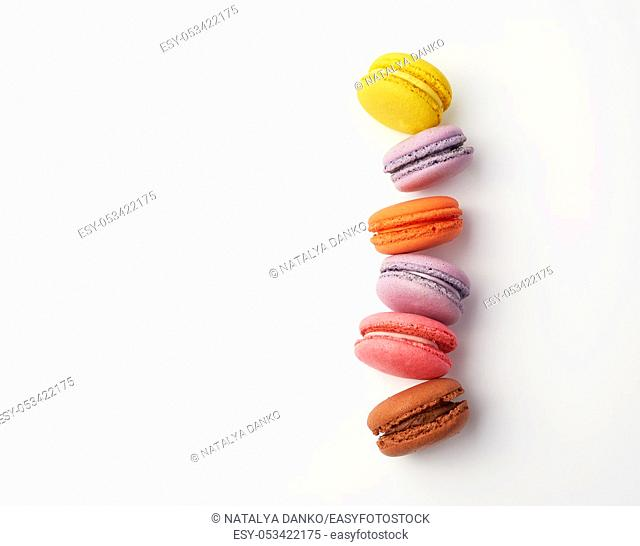 stack of colorful baked macaron almond flour on a white background, copy space, flat lay