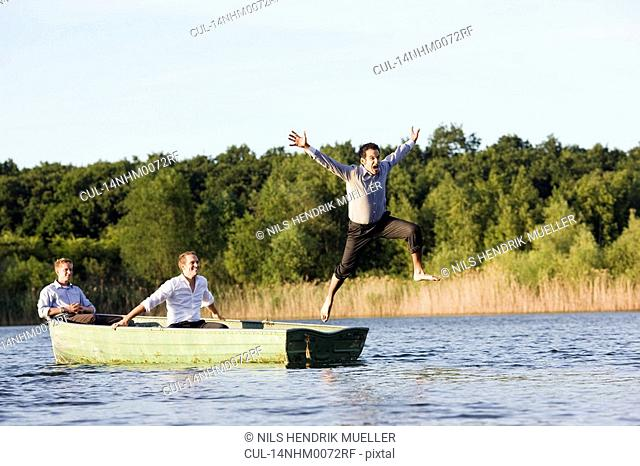 businessman jumping of rowboat