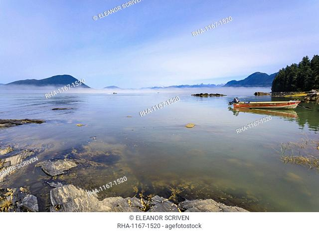 Jet-boats head for the Stikine River, mist clears from beautiful Petroglyph Beach, State Historic Park, Wrangell, Alaska, United States of America