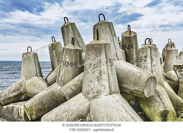 Tetrapods are concrete blocks used in coastal protection structures. Tetrapods are strung together along the coastline, at docks or jetties or stacked in...