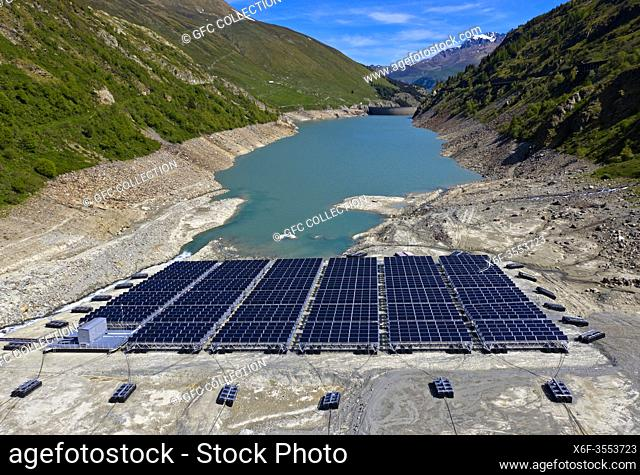 Solar panels of the first floating alpine solar power plant of the Swiss energy company Romande Energie lying on the lake floor due to the low water level of...