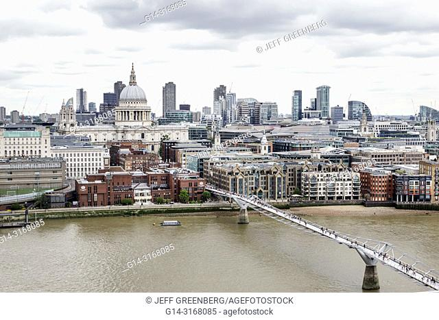 United Kingdom Great Britain England, London, Bankside, River Thames, Tate Modern art museum terrace view, city skyline, gray sky, Millennium Bridge