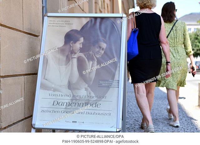 "05 June 2019, Thuringia, Weimar: A display in front of the entrance advertises the exhibition """"From Shirt to Hanging Dress: Ladies' Fashion between Goethe's..."